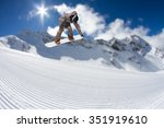 flying snowboarder on mountains.... | Shutterstock . vector #351919610