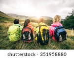 Four Backpackers Looking At...