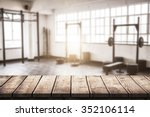 wooden table against gym | Shutterstock . vector #352106114