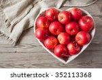 red apples on a table | Shutterstock . vector #352113368
