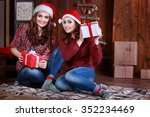 Two Teen Girls In Santa Hats...