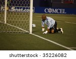 EAST RUTHERFORD NJ - AUGUST 12: Renny Vega #1 of Venezuela after allowing goal against Colombia during the International Friendly match at Giants Stadium on August 12 2009 in East Rutherford NJ - stock photo