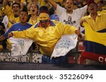 EAST RUTHERFORD NJ - AUGUST 12: Fans celebrate the first goal by Colombia against Venezuela during the International Friendly match at Giants Stadium on August 12 2009 in East Rutherford NJ - stock photo