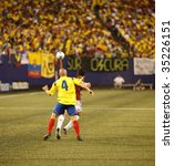 EAST RUTHERFORD NJ - AUGUST 12: Vladimir Marin #4 of Colombia handles the ball against Venezuela during the International Friendly match at Giants Stadium on August 12 2009 in East Rutherford NJ - stock photo