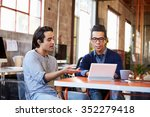 two designers sit at meeting... | Shutterstock . vector #352279418
