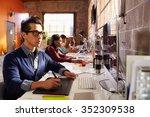 designers working at desks in... | Shutterstock . vector #352309538