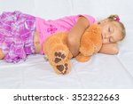young child girl sleeping with... | Shutterstock . vector #352322663