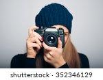 happy girl photographed in... | Shutterstock . vector #352346129