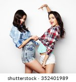 two young girl friends standing ... | Shutterstock . vector #352401989