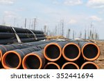 drillpipe stacked near rig  | Shutterstock . vector #352441694