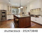 kitchen with white cabinetry... | Shutterstock . vector #352473848