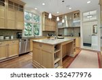 Stock photo kitchen with oak wood cabinetry and granite counter 352477976