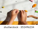 child hands with plasticine in... | Shutterstock . vector #352496234