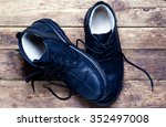 black leather men's shoes on a... | Shutterstock . vector #352497008