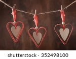 red hearts hanging over old... | Shutterstock . vector #352498100