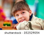 portrait of young smiling boy ... | Shutterstock . vector #352529054