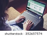 woman buys by internet with a... | Shutterstock . vector #352657574