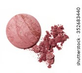 Small photo of pink crumbled blush eyeshadow on white background