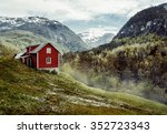 Wooden cottage in the valley. Flowers. Stone snowy mountains. Stalheim, Norway. Fog. Vintage - stock photo