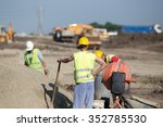 Construction Workers Standing...