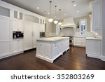 Stock photo kitchen in new construction home with center island 352803269
