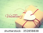 gift decorated with wooden heart | Shutterstock . vector #352858838