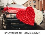 Wedding Car Decorated With Two...