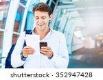 man using smart phone to book... | Shutterstock . vector #352947428