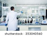 Interior of clean modern white medical or chemical laboratory background. Laboratory concept with caucasian male chemist. Horizontal template for a poster, webpage or leaflet. - stock photo
