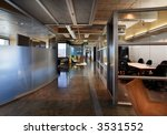 Modern office interior with glass walls - stock photo