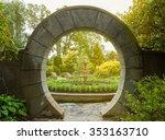 Stone Archway In Flower Garden