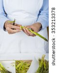 trim and peel asparagus in the... | Shutterstock . vector #353213378