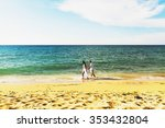 smiling couple holding hands in ... | Shutterstock . vector #353432804