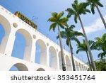 Small photo of Train drives along distinctive white arches of the landmark Lapa Arches in Rio de Janeiro, Brazil