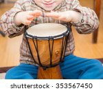 small child playing on drum.... | Shutterstock . vector #353567450