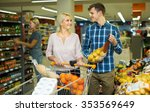 family couple buying sweet... | Shutterstock . vector #353569649