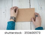 Woman Reading Notepad. Holding...