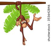 Cute Monkey Hanging On The Tre...
