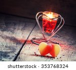 Valentine's Day composition with sweet hearts with burning red candles, selective focus