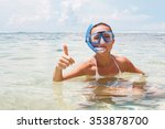happy woman on the beach with a ...   Shutterstock . vector #353878700