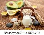fresh avocado on cutting board... | Shutterstock . vector #354028610