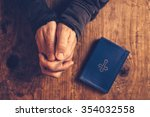christian man praying with... | Shutterstock . vector #354032558