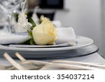 Details of a wedding table with a yellow rose - stock photo