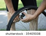adult male inflating tire | Shutterstock . vector #35405038