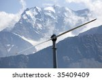 An high mountain wind turbine to supply energy to a remote area - stock photo