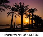 palm trees silhouette at sunset | Shutterstock . vector #354130283