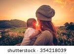 young mother standing near a... | Shutterstock . vector #354218039