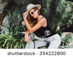 Young Girl In Sunglasses Hat...