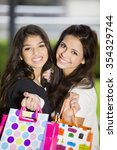 Happy Friends With Shopping Bags