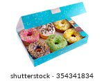 colored donuts in the blue box...   Shutterstock . vector #354341834